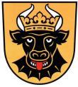 Bild des Wappens der Stadt. Schwarzer Stierkopf mit Krone auf orangegelblichem Hintergrund